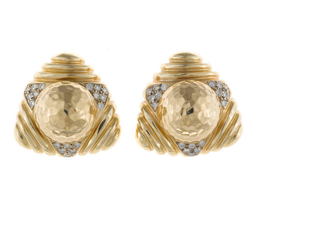 A pair of diamond and fourteen karat gold earrings