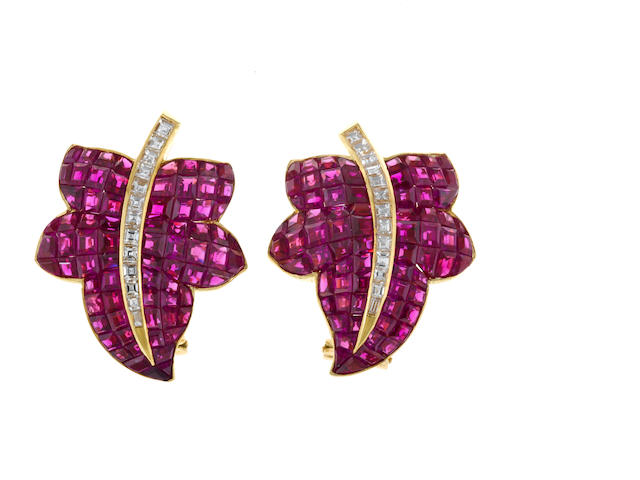 A pair of ruby and diamond leaf earrings