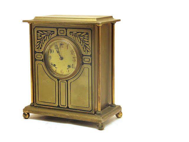 An Arts and Crafts brass mantel clock  first quarter 20th century