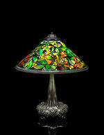A Tiffany Studios Favrile glass and bronze Trumpet Creeper table lamp circa 1910
