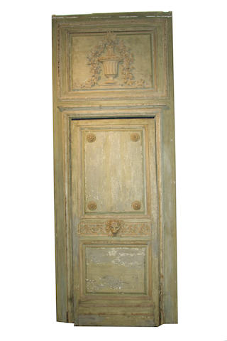 An Italian Neoclassical paint decorated and parcel gilt door with surround