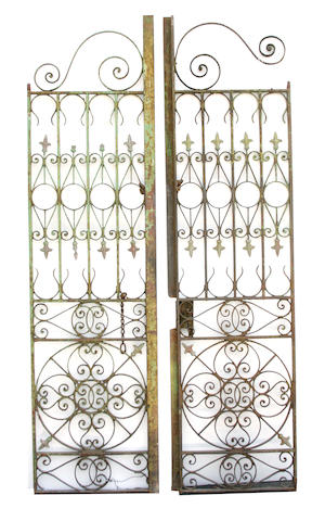 A pair of paint decorated iron garden gates