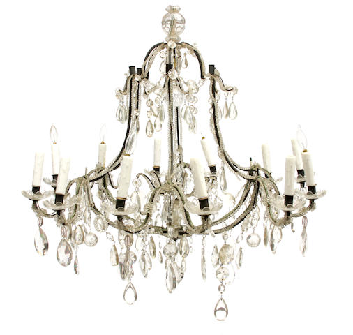 A Louis XV style patinated metal and cut glass ten light chandelier