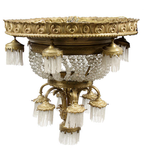 A Beaux Arts gilt bronze and glass thirteen light chandelier