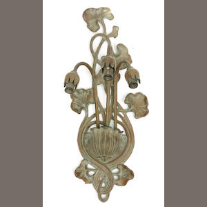 A pair of Art Nouveau style patinated bronze three light wall lights with lily shades