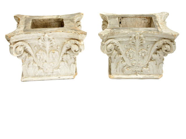 A pair of Neoclassical style terracotta capital form planters