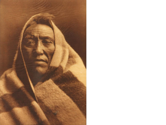 Edward S. Curtis (American, 1868-1952); hole in image; sheet trimmed to image Middle Calf-Piegan;