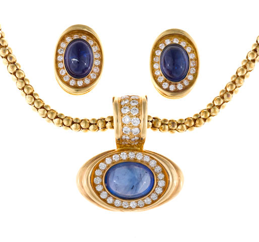 A sapphire and diamond pendant/necklace together with matching earrings