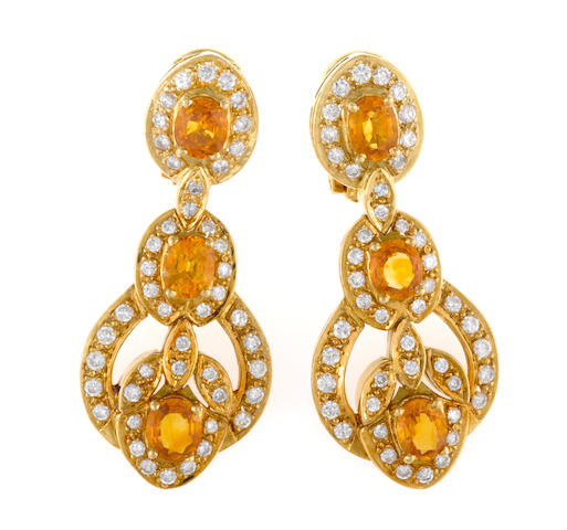 A pair of yellow sapphire and diamond earrings