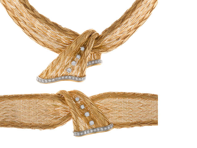A diamond and eighteen karat gold scarf motif necklace together with matching bracelet