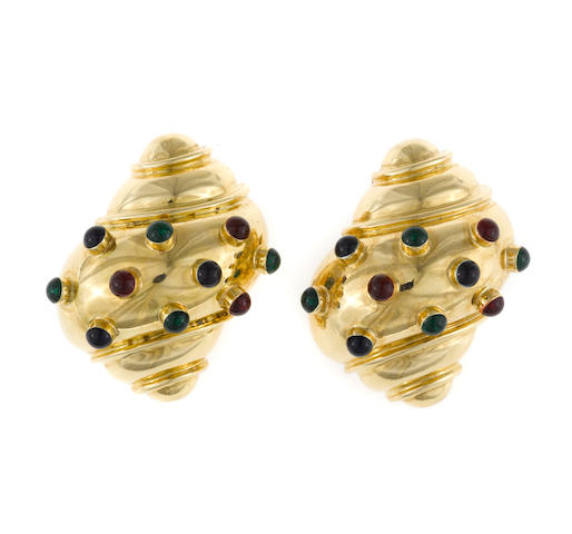 A pair of eighteen karat gold and paste spiral shell motif earrings