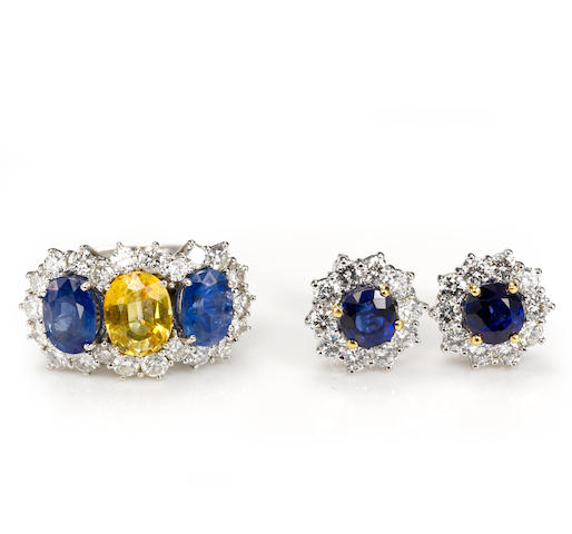 A yellow and blue sapphire and diamond ring together with earrings, including Garrard
