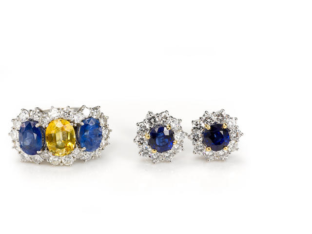 A yellow and blue sapphire and diamond ring together with earrings, including Garrard, English