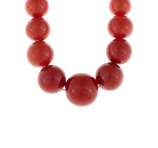 A coral bead graduated necklace