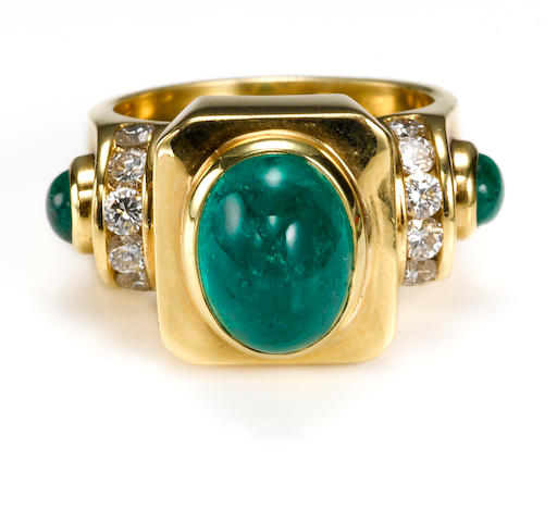 An emerald cabochon and diamond ring