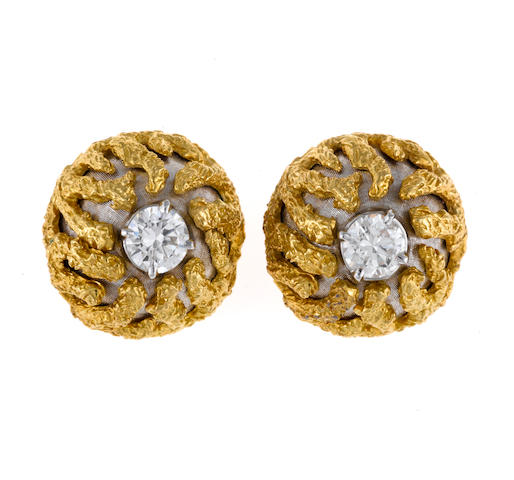 A pair of diamond and eighteen karat bicolor gold earclips, Cellino