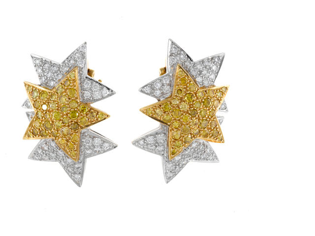 A pair of yellow diamond and diamond star motif earrings, Gioia