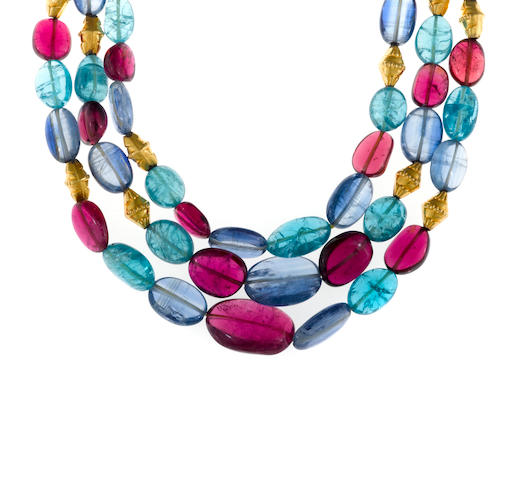 A rubellite tourmaline, apatite, kyanite and eighteen karat gold bead triple-strand necklace