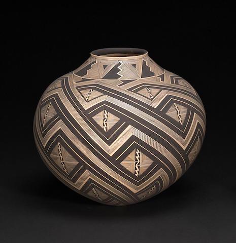 A Navajo fine line pottery jar