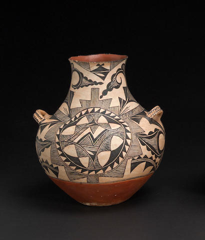 An Acoma black painted handled olla