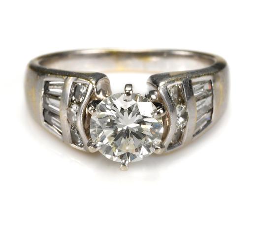 A diamond and eighteen karat gold ring together with a diamond and fourteen karat gold band