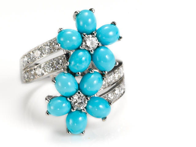 A turquoise and diamond flower bypass ring
