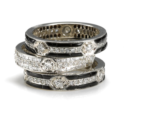 A collection of three diamond and black onyx eternity bands