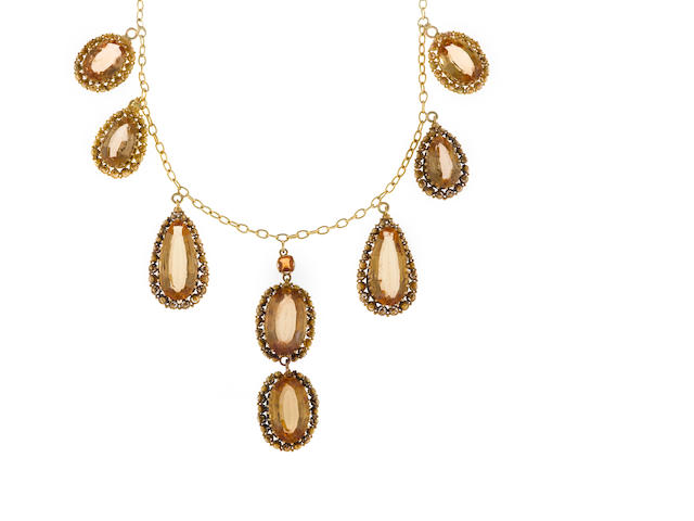 A topaz and eighteen karat gold necklace, French