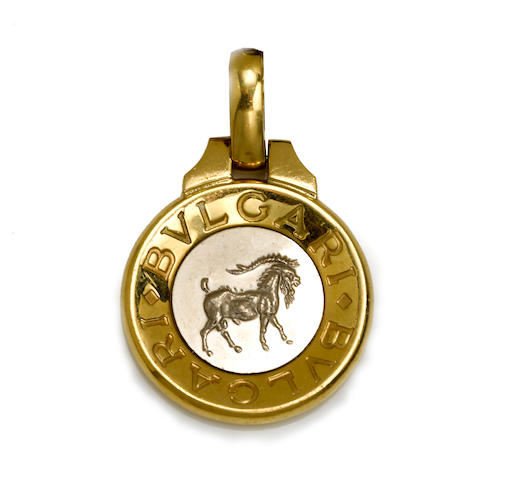 An eighteen karat bicolor gold and leather capricorn pendant/necklace, Bulgari