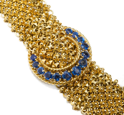 A sapphire and eighteen karat gold mesh bracelet, French