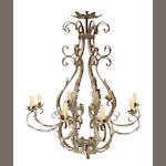 A Baroque style paint decorated iron eight light chandelier