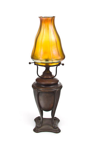 A Tiffany Studios gold Favrile glass and bronze table lamp  1899-1918