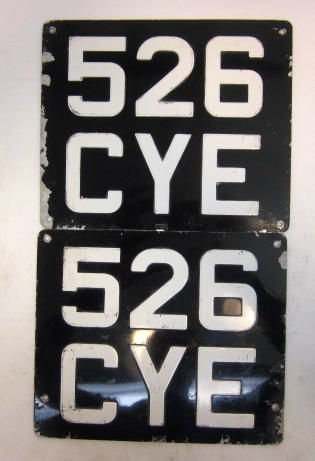 A set of U.K. licence plates,