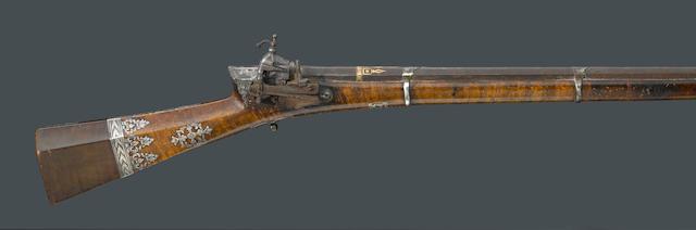 A silver-mounted Ottoman miquelet long gun