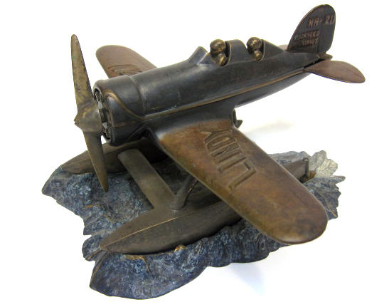 A bronzs sculpture of Charles and Ann Lindbergh's Lockheed Sirius NR-211,