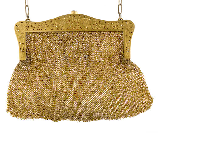 A fourteen karat gold purse