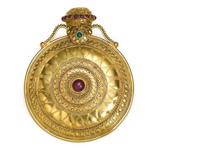 A ruby, emerald and twenty-two karat gold pendant/brooch