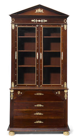 An Empire style gilt bronze mounted mahogany secretary cabinet