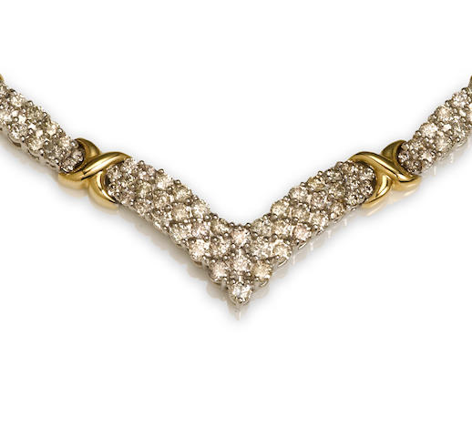 "A diamond and 14k bicolor gold ""x"" motif necklace"