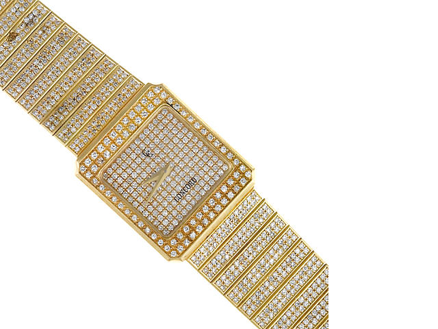 A diamond and eighteen karat gold backwind integral bracelet wristwatch, Concord