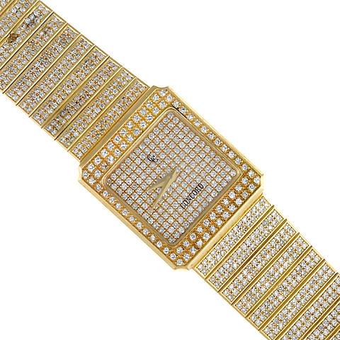 A diamond and eighteen karat gold backwind integral bracelet wristwatch, Concord