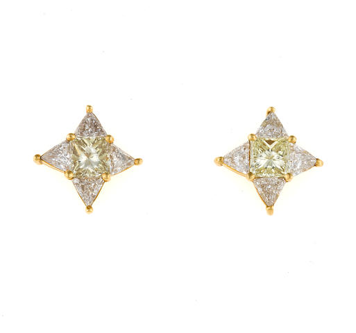 A pair of yellow diamond and diamond four-point star earrings