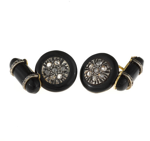 A pair of black onyx and diamond cufflinks