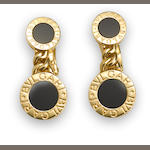 A pair of black onyx and eighteen karat gold earclips, Bulgari