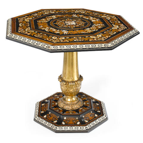 A good quality Italian parcel gilt, bone inlaid and marquetry tilt top center table  attributed to Giovanni Battista Gatti  mid 19th century