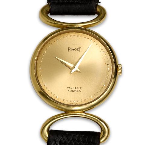 An eighteen karat gold modified strap wristwatch, Piaget, retailed by Van Cleef & Arpels