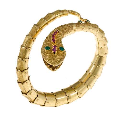 A ruby, dyed green chalcedony and fourteen karat gold flexible snake bangle bracelet