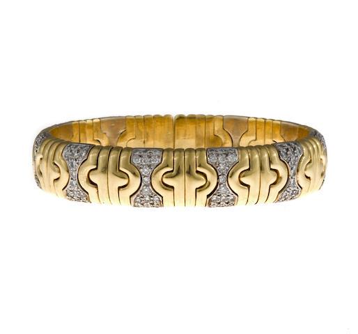 A diamond and eighteen karat bicolor gold cuff bracelet