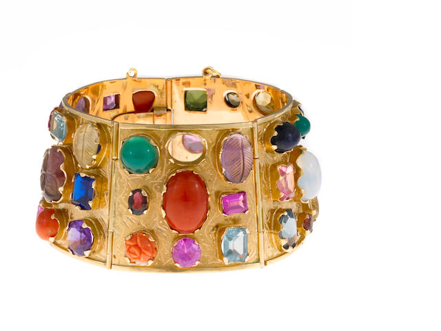 A gem-set, hardstone and synthetic gem bangle bracelet