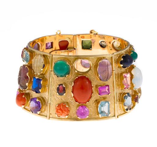 A gem-set, hardstone and synthetic gem bangle bracelet